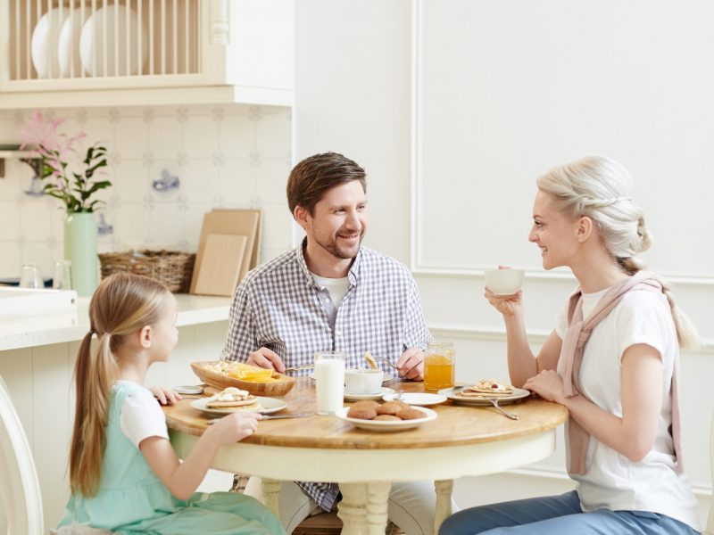 Talkative family enjoying breakfast