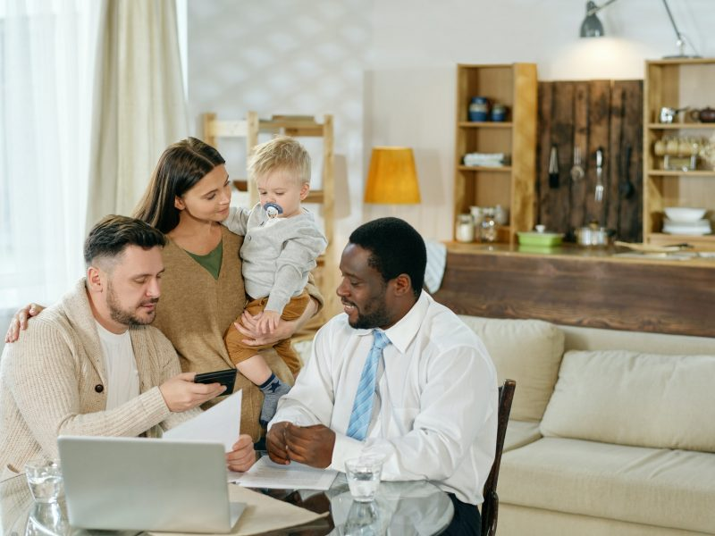 Young family and financial consultant at home